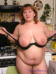 BBW getting naked on the kitchen